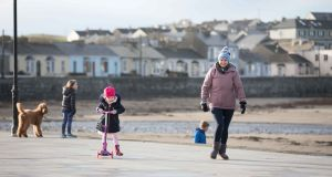Paula and Freya Crotty, who recently moved back to Kilkee from Limerick, out for a walk on the beach. Photograph: Eamon Ward
