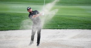Tyrrell Hatton plays his third shot on the eighth  hole during day two  of the Abu Dhabi HSBC Championship at Abu Dhabi Golf Club. Photograph: Ross Kinnaird/Getty Images