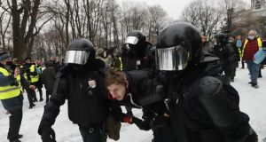 Russian special police units officers detain a protester during an unauthorised protest in support of Russian opposition leader and anti-corruption activist Alexei Navalny, in St Petersburg on Saturday. Photograph: Anatoly Maltsev/EPA