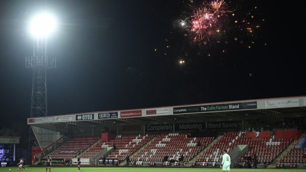 Fireworks are set off during Cheltenham's clash with Manchester City. Photograph: Toby Melville /EPA