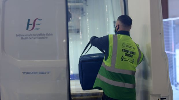 A driver loads Pfizer/BioNTech vaccines into a refrigerated van after collecting them from the National Cold Chain Distribution Centre. Photograph: Alan Betson