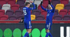 James Maddison celebrates with Harvey Barnes after scoring Leicester's third against Brentford. Photograph: Ben Stansall/Getty/AFP