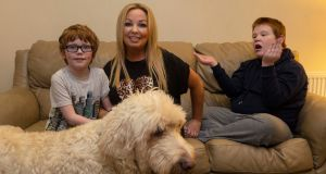 Eleanor Bermingham with her sons Mikey (13) and Darragh (8) and their dog, Ralph, at home in Newcastle, Co Dublin. Photograph: Damien Eagers