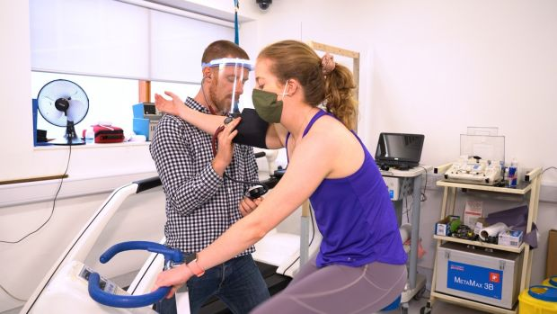 Neil Fleming, exercise physiologist, at the Human Performance Lab at the School of Medicine, Trinity College, with Aoife McGovern. Photograph: Mark Sheridan