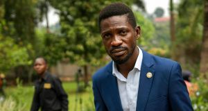 In this January 15th, 2021 photograph, Uganda's leading opposition challenger, Bobi Wine, walks back to his residence after giving a press conference outside Kampala, Uganda. Photograph: Jerome Delay/ AP