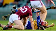 Tipperary's Séamus Callanan tackled by Galway's Adrian Tuohy  late in the All-Ireland quarter-final at the Gaelic Grounds. Photograph: James Crombie/Inpho