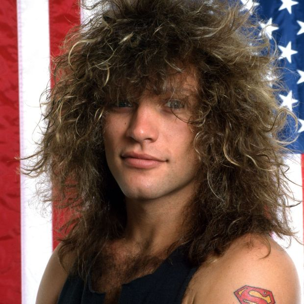 DETROIT - JUNE 1985: American singer-songwriter, actor and namesake of the rock band Bon Jovi poses for a portrait in front of the American flag, June, 1985, in Detroit, MI. Photograph: Ross Marino/Getty Images