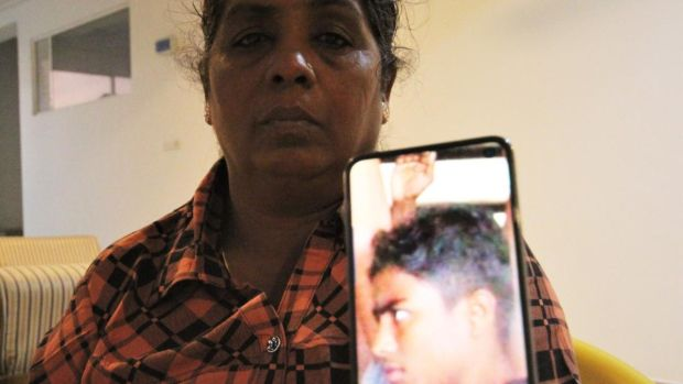 Jayakumari Balendran, an activist for the civil war's missing, displays a picture of her son Mahinthan (15). Photograph: Tom Farrell