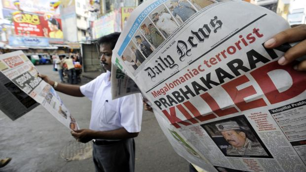 A man looks at a newspaper that details the end of the near four-decades long ethnic conflict in Colombo in May 2009. Photograph: Ishara S Kodikara/AFP via Getty Images