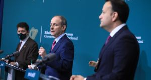Taoiseach Micheál Martin, Tánaiste Leo Varadkar and Minister for the Environment Eamon Ryan  at the post-Cabinet press briefing in Government Buildings, Dublin. Photograph: Julien Behal