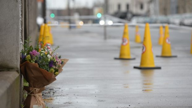 Flowers at the scene on East Wall Road in Dublin where teenager Josh Dunne was fatally stabbed and two others were injured. Photograph: Dara Mac Donaill