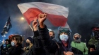 Thousands protest in Poland as near total abortion ban becomes law