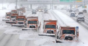 Wisconsin snow storm. When researchers combed through the biographies of 1,188 board members at the 100 largest US companies,  they found just three directors had specific climate expertise. Photograph: John Hart/Wisconsin State Journal via AP
