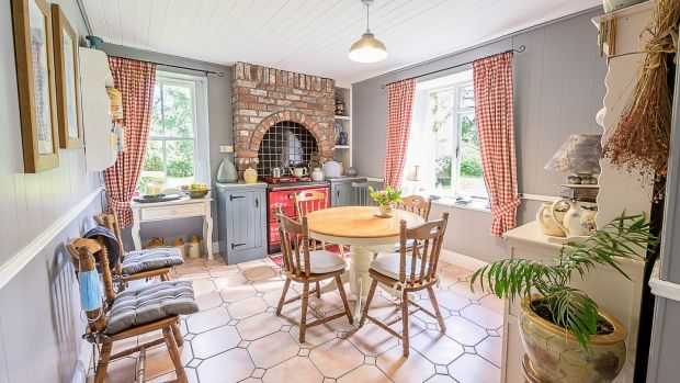 This charming four-bed is set on 1.75 acres of beautifully maintained gardens bounded to the north by the river Clodagh.
