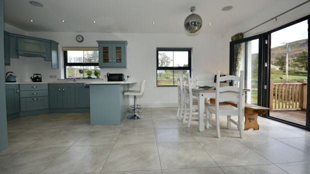 The 171sq m/1,840sq ft property has an open-plan kitchen-living area running the depth of the property.