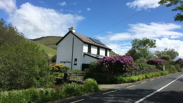 The Old School House is between Leenane and Maam Cross.