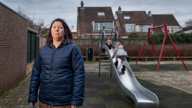 "Vanessa van Ewijk and her two children in Lisserbroek, the Netherlands. ""How do I tell my kids that they could possibly have 300 siblings?"" she said. Photograph: Ilvy Njiokiktjien/The New York Times"