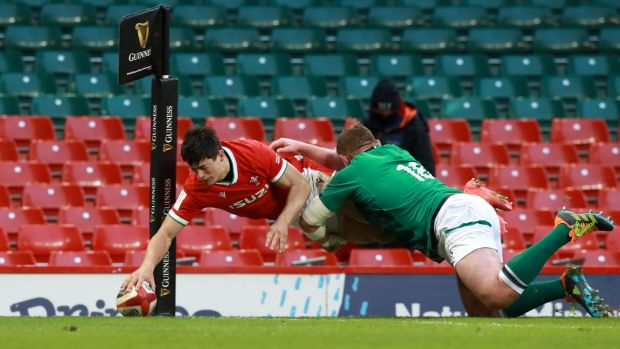 Louis Rees-Zammit touches down to score Wales's second try as Tadhg Furlong attempts to tackle during the Guinness Six Nations match between Wales and Ireland at the Principality Stadium in Cardiff on Sunday. Photograph: David Rogers/Getty Images