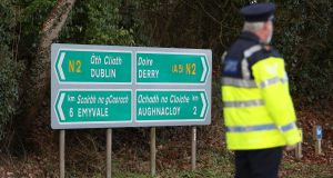 Garda stop vehicles at a checkpoint at the  Border between Emyvale and Aughnacloy. Photograph: Liam McBurney/PA Wire
