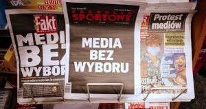 Daily newspapers headlines with a special message 'Media without choice' at one of the kiosks in the centre of Warsaw, Poland. Photograph: Albert Zawada/EPA