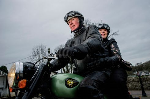 WHEEL LOVE: Cork couple Andy and Eileen Casey from Kileens on their restored BSA motorbike at Blarney Square, where they first met 57 years ago. Photograph: Daragh Mc Sweeney/Provision