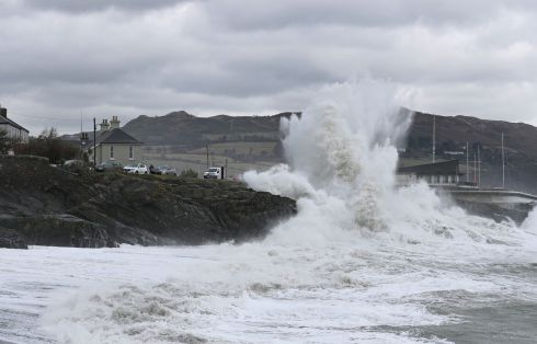 MAKING A SPLASH: Waves pounding the shoreline in Greystones, Co Wicklow, as southeasterly winds brought high seas and bitter cold to the East coast. Photograph: Nick Bradshaw