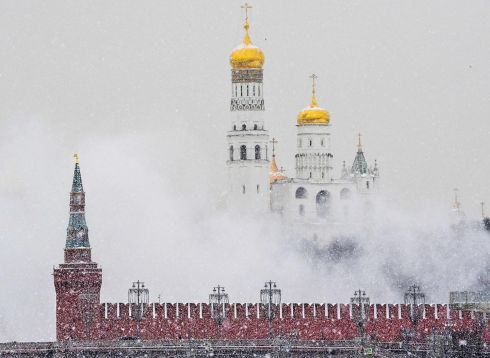 MOSCOW SNOW: Snow falls over the Kremlin in central Moscow, Russia. Photograph: Yuri Kadobnov/AFP via Getty