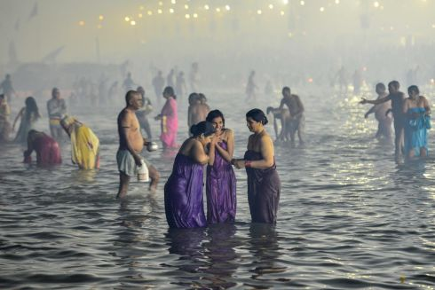 HOLY BATH: Hindu people take a holy bath at the Sangam confluence of rivers on Mauni Amavasya, the day of bathing, during the annual festival of Magh Mela in Allahabad in India. Photograph: Sanjay Kanojia/AFP via Getty