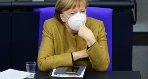 German Chancellor Angela Merkel looks on with a face mask on during a session of the German Bundestag on Thursday. Photograph: Clemens Bilan/EPA