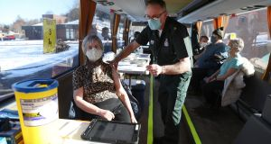 Paramedic Paul Kelly vaccinates Marion Matheson inside a holiday coach outside Culloden Medical Practice near Inverness, Scotland. The Scots have accelerated their vaccination programme to more than 60,000 jabs a day in recent days.  . Photograph:  Andrew Milligan/PA