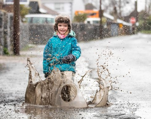 SPLASH DOWN: Saoirse Cape plays in the puddles outside her house in Rush after the heavy rain over the weekend. Photograph: Conor Healy/Picture It