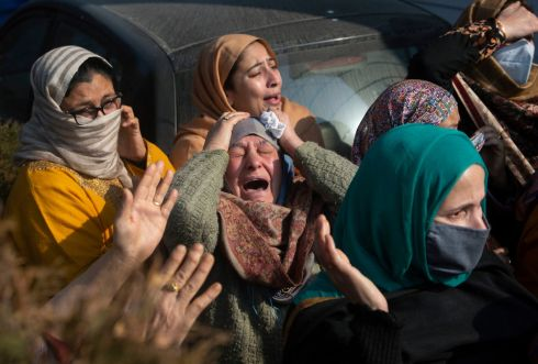 KASHMIR: Relatives of Basharat Ahmad Zargar cry during his funeral in Srinagar, Indian-controlled Kashmir on Sunday. Zargar, who was working at a power project, was among the dozens killed after a part of a Himalayan glacier broke off on February 7th sending a devastating flood downriver slamming into two hydropower projects in northern India. Photograph: Mukhtar Khan/AP