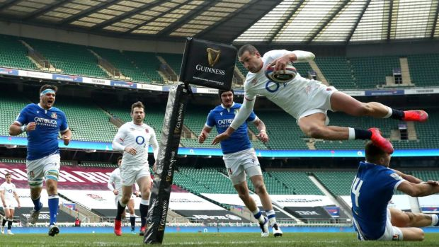Jonny May dives over Luca Sperandio to score against Italy. Photograph: David Rogers/Getty