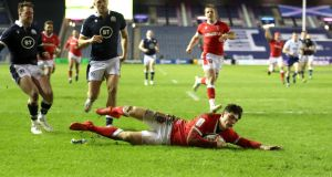 Wales' Louis Rees-Zammit dives to score during his side's win over Scotland. Photograph:  Jane Barlow/PA