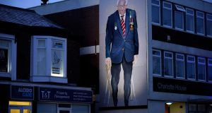A mural of the late Sir Tom Moore, by artist Robert Newbiggin, adorns a wall in Southport, England. Photograph: Christopher Furlong/Getty Images