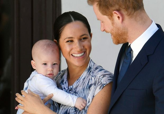 Britain's Prince Harry and his wife Meghan holding their son Archie at the Desmond and Leah Tutu Legacy Foundation in Cape Town, South Africa in September 2019. Photograph: Toby Melville/EPA