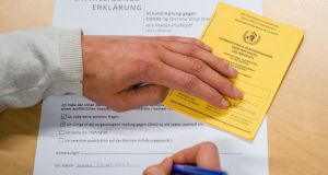 Many countries already require travellers carry an  International Certificate of Vaccination or Prophylaxis (ICVP), also known as the Carte Jaune or Yellow Card to confirm vaccination against yellow fever. Photograph: Jens Schlueter/AFP