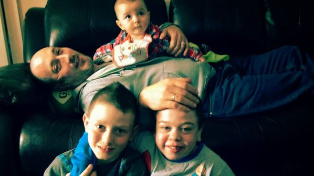 Geraldine's husband Dave with children Jack, Ethan and Daniel (top).