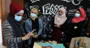 Palestinian women with  impaired hearing get cartoon production training:  Female literacy in Gaza is 93 per cent, only 5 per cent less than males. Photograph: Majdi Fathi/NurPhoto