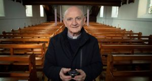 Fr Brian Brady with the last container of ashes in St Mary's Church in Clonmany, Co Donegal. Photograph: Joe Dunne