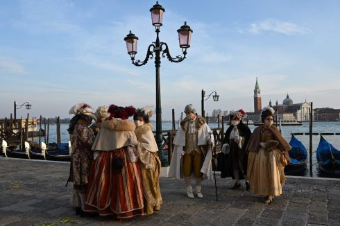 VENICE CARNIVAL: Venetians wearing face masks and carnival costumes parade in Venice despite the carnival being cancelled due to the Covid-19 pandemic. Photograph: Francois-Xavier Marit/AFP via Getty