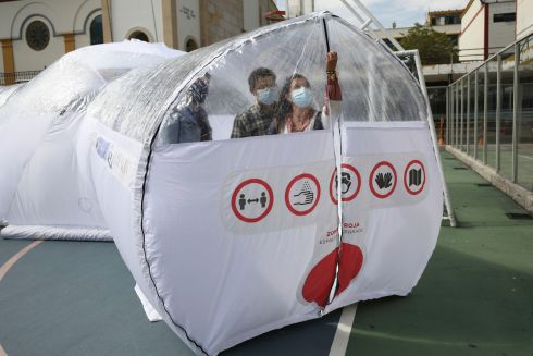 ISOLATION DOMES: Designers stand inside their portable epidemiological insulation unit, which can be used to isolate and facilitate treatment of Covid-19, in Bogota, Colombia. Photograph: Fernando Vergara/AP