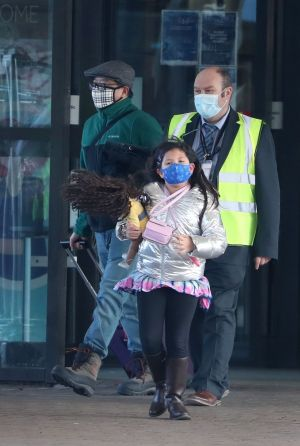 QUARANTINE MISTAKE: Chun Wong and his daughter Kiernan (8) leave the DoubleTree by Hilton Hotel at Edinburgh Airport after they were mistakenly made to quarantine there despite a loophole in the rules. Photograph: Andrew Milligan/PA Wire