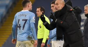 Pep Guardiola gives instructions to  Phil Foden. The Manchester City boss will be hoping to see his side strengthen their grip at the top of the league with victory at Everton.   Photograph: Rui/Vieira/AFP/Getty