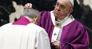 Pope Francis sprinkles ashes on a cardinal's head as he  leads Catholics into Lent with the Ash Wednesday mass at St  Peter's Basilica at the Vatican. Photograph: