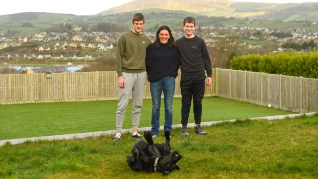 Olive Foley with her sons Tony (15) and Dan (12) and Trapper the dog at their home in Killaloe, Co Clare. Photograph: Diarmuid Greene