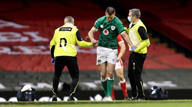 Johnny Sexton gets treatment from Dr. Ciaran Cosgrave and physio Keith Fox having suffered a head injury in the game against Wales at the Principality Stadium. Photograph: Laszlo Geczo/Inpho