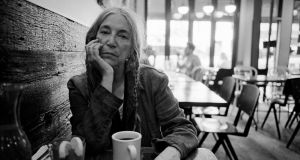 "Ticket Books of the Year 2019.   Patti Smith at her local coffee shop in SoHo, Sept. 11, 2019. In her new book, ""Year of the Monkey,"" Smith, who is working toward a third act as a novelist, blends fiction and reality, conjured characters and actual ones. It's not always clear when you're in her imagination or out of it. (Andre D. Wagner/The New York Times) -- STANDALONE PHOTO FOR USE AS DESIRED WITH YEAREND REVIEWS --"