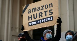 Amazon workers and community allies demonstrate during a protest in front of the Jeff Bezos' Manhattan residence in New York last December. Photograph: Getty Images