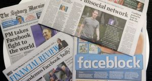 Front pages of Australian newspapers are displayed featuring stories about Facebook in Sydney on Friday. Photograph: Rick Rycroft/AP
